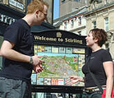 couple beside Stirling Map in town centre